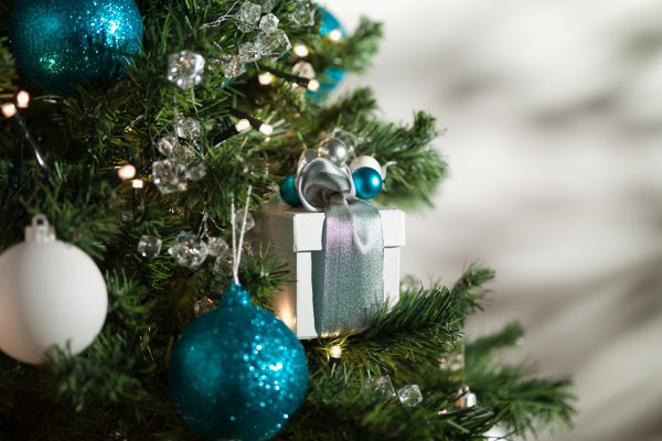Christmas gift and ornaments on tree