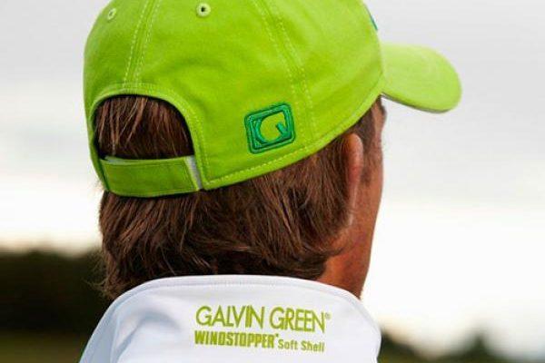 Man in green golf hat